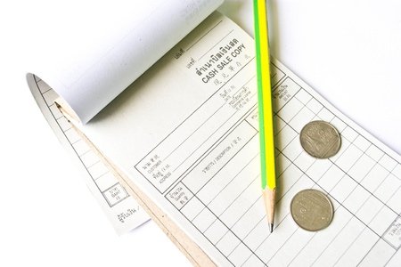 cash book: Receipt, pencil and Coins on a white background