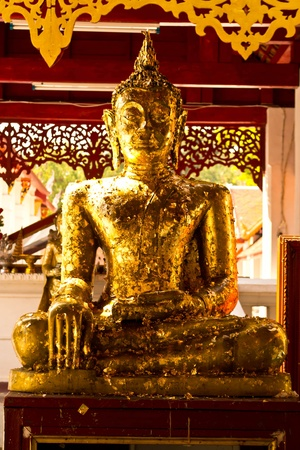 Buddha statue with gold leaf in Thailand photo