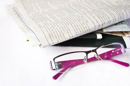 glasses on a newspaper photo