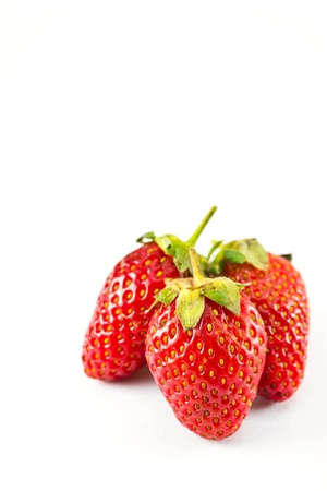 strawberries placed on a white background  photo