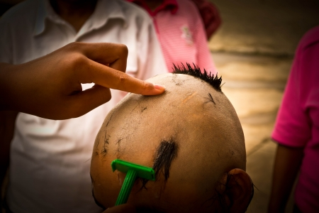 ordination: Shaving heads for ordination. Buddhist religious traditions