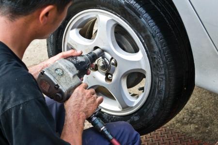 pneumatic tyres: Auto mechanic changing car wheel