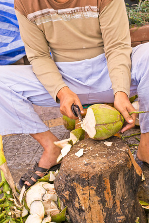 paring: uncle is using coconut paring knife
