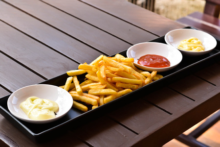 french fries plate: French fries on a plate with ketchup