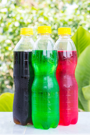 aerated: bottles with tasty drinks white nature background