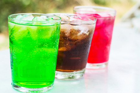 soft drink in a glass with ice cubes