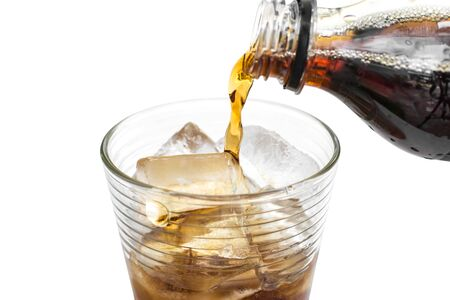 poured: soft drink being poured into glass with ice cubes