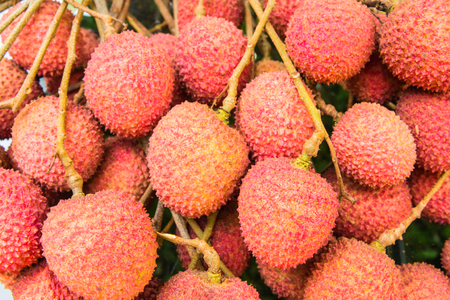 Fresh lychee fruit showing the red skin