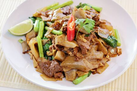 stir fried: Stir Fried fat Noodles With Chinese Broccoli (Pad See Eiw) Stock Photo