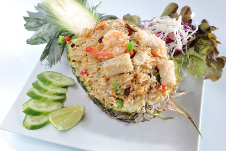 mussle: pineapple fried rice seafood served in a fresh pineapple shell, thai food