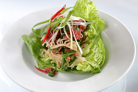 raw beef: raw beef salad served with fresh vegetable, thai food