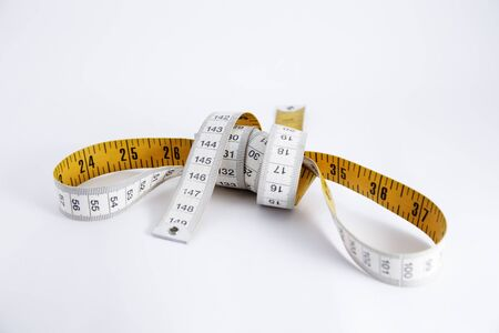 inch: measuring tape isolated on white background