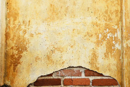 Old moldy red-brick wall in the church