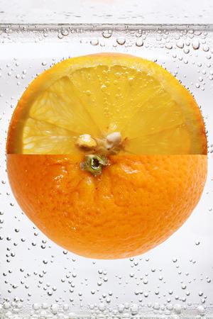 Orange fruit in carbonated soda macro shot Banco de Imagens