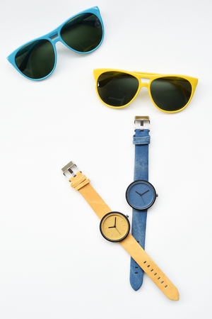 Wrist watch and sunglasses isolated on white background.