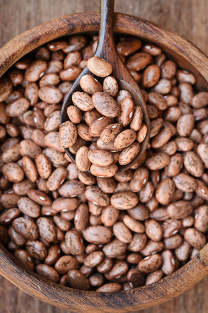 Pinto bean in wooden bowl for background Stock Photo