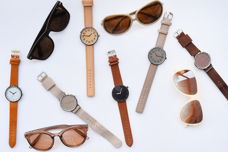 Modern fashionable sunglasses and set of multicolored wristwatch isolated on white background