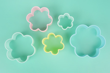 Close up of flower shaped of dessert plastic mold in multi color for background