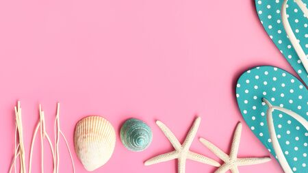 close up of sandals and starfish on pink background Stock Photo