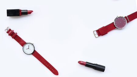 close up of color lipsticks with wrist watches isolated on white background