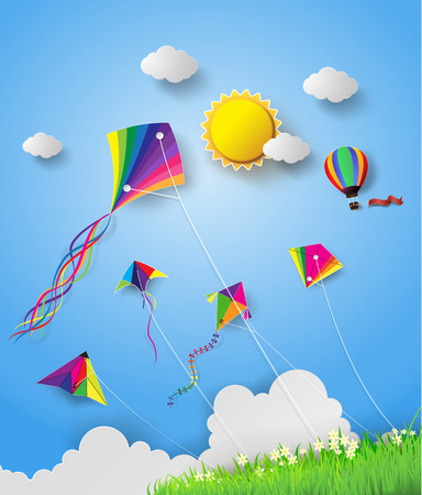 Colorful kite flying on the sky.