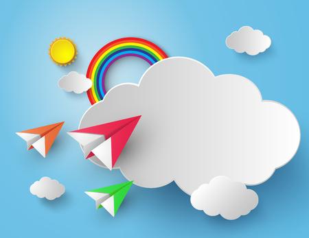 avion en papier sur un ciel bleu avec arc-en-ciel
