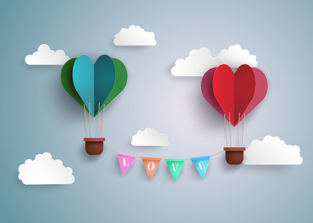 Origami made hot air balloon in a heart shape.
