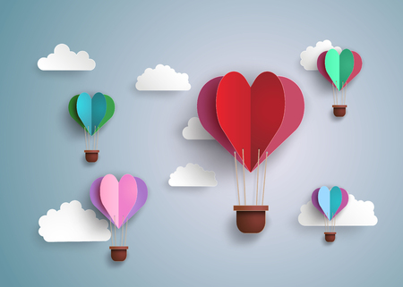 balloons celebration: Origami made hot air balloon in a heart shape.