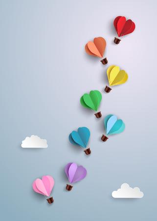 Origami made hot air balloon in a heart shape.