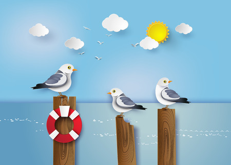 wooden post: Seagull standing on a wooden post beside the seaside