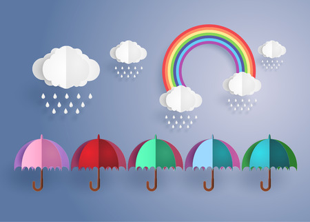 wet flies: origami made colorful umbrella in the air with rainning