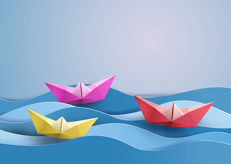 origami made colorful paper sailing boat