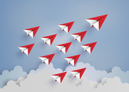 planes: leadership concept with red paper plane on blue sky.paper art style.