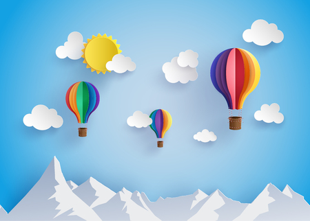 Origami made colorful hot air balloon flyin over moutain with cloud.paper art style.