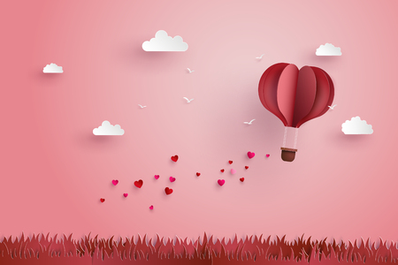 illustration of love and valentine day,Origami made hot air balloon fly over grass with heart float on the sky.paper art style.