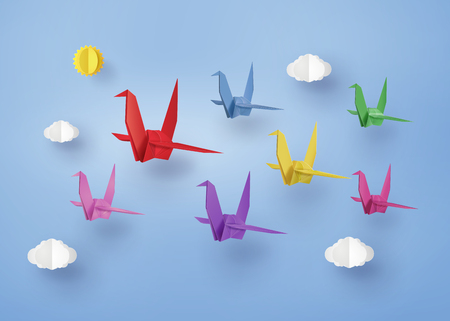 Origami Made Colorful Paper Bird Flying On Blue Sky With Cloud