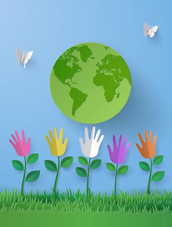 풀밭과 세계에 멀티 컬러 손으로 꽃 에코 개념의 종이 예술.