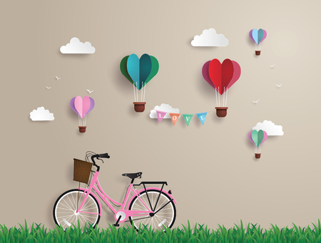 Pink bikes parked on the grass with heart shaped balloons  floating on the sky.paper art and origami style.