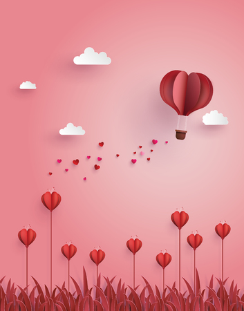Greeting card of hot air balloon  fly over flower field ,concept of love and Valentine's Day.