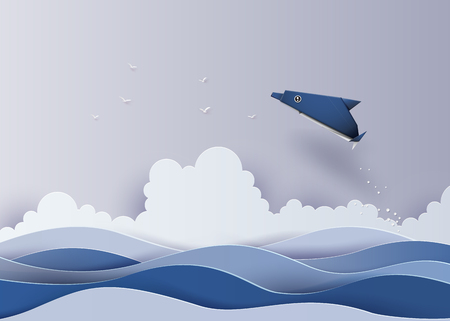Origami made dolphin in the sea.The illustrations do the same paper art and craft style