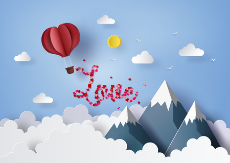 Origami red heart hot air balloon flying on blue sky, paper art concept of valentines day and wedding