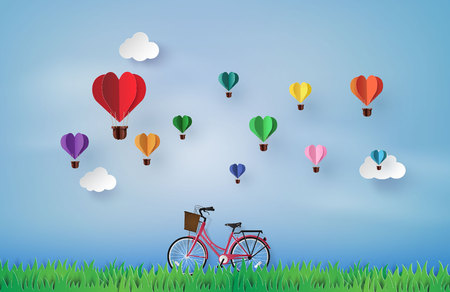 Bicycle in the garden with colorful hot air balloon heart shap. paper art 3d from digital craft. Illusztráció