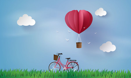 love and valentine day,Origami made hot air balloon fly over grass  and red bicycle .paper art style. Stock Illustratie