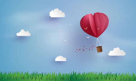 love and valentine day,Origami made hot air balloon fly over grass .paper art style.