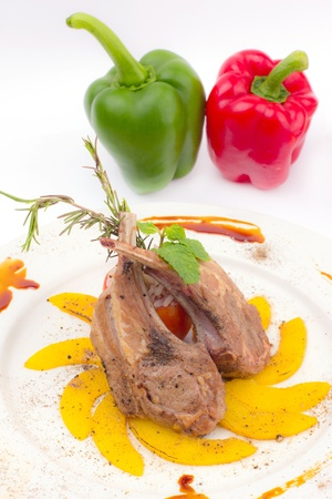 Rack of Lamb with Grilled Peach on white dish photo