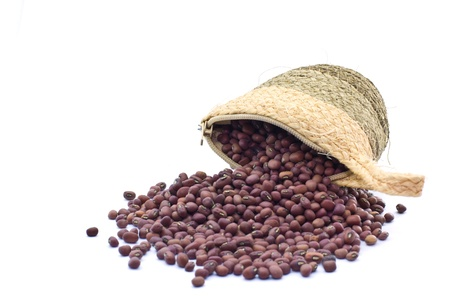 azuki bean: sack with red beans, azuki bean spilling out over a white background