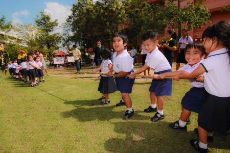 Nakornratchasima , Thailand - November 4: unidentified children on fun compete in tug of war on the Field during Childrens sport events. November 4, 2012,