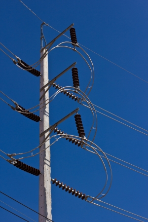 high voltage electricity pole in blue sky Stock Photo - 16912101