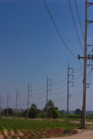 voltage gray: high voltage electricity pole in blue sky