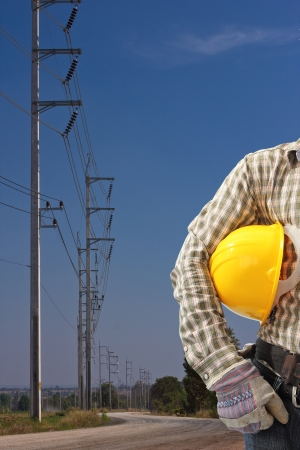 electric utility: engineer with high voltage electricity pole in blue sky Stock Photo